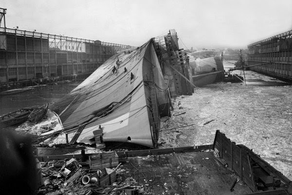 The Normandie lying on its side after capsizing at the Hudson River pier in 1942.