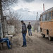 Waiting for a bus in Atotsi village, near the border which Russia has reinforced with a fence.