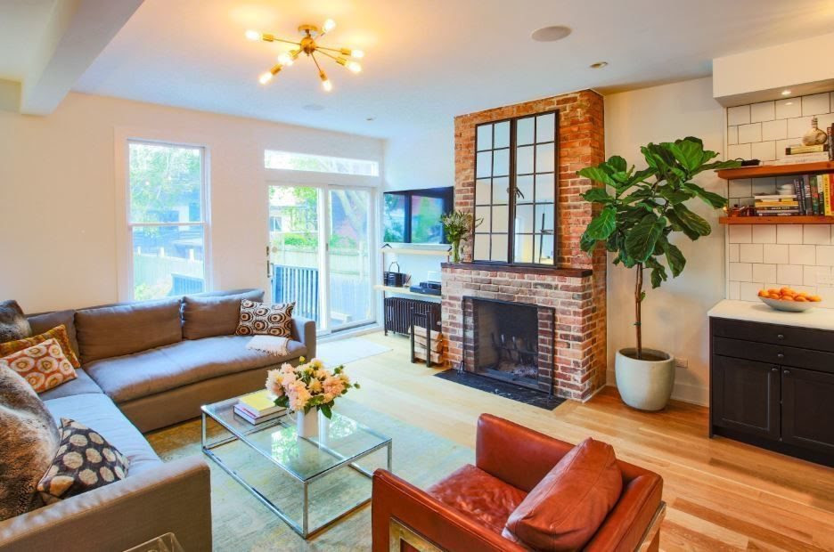 living room with fireplaces and patio door