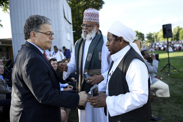 Sen. Al Franken (D-Minn.) shakes hands with Sa'ad Musse Roble, center, with the World Peace Organization, and Omer Andi Nur, visiting from Michigan, after Franken spoke at a rally at Dar Al-Farooq Islamic Center in Bloomington, Minn. The suburban Minneapolis mosque was bombed Aug. 5 as worshippers were about to start their morning prayers. No one was hurt. (Aaron Lavinsky/Star Tribune via AP)