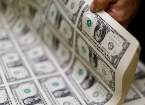 A stack of printed dollar bills