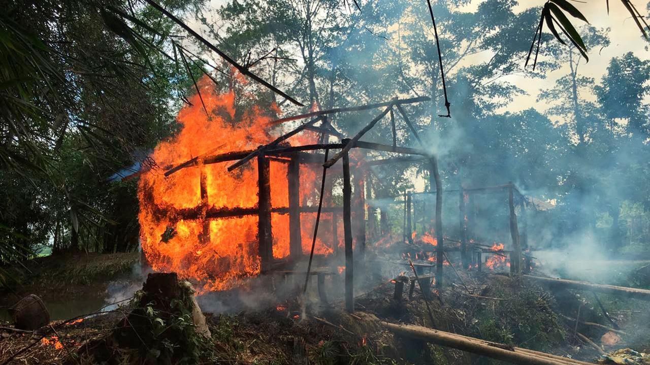 Houses are on fire in Gawdu Zara village, northern Rakhine state, Myanmar, Sept. 7, 2017.