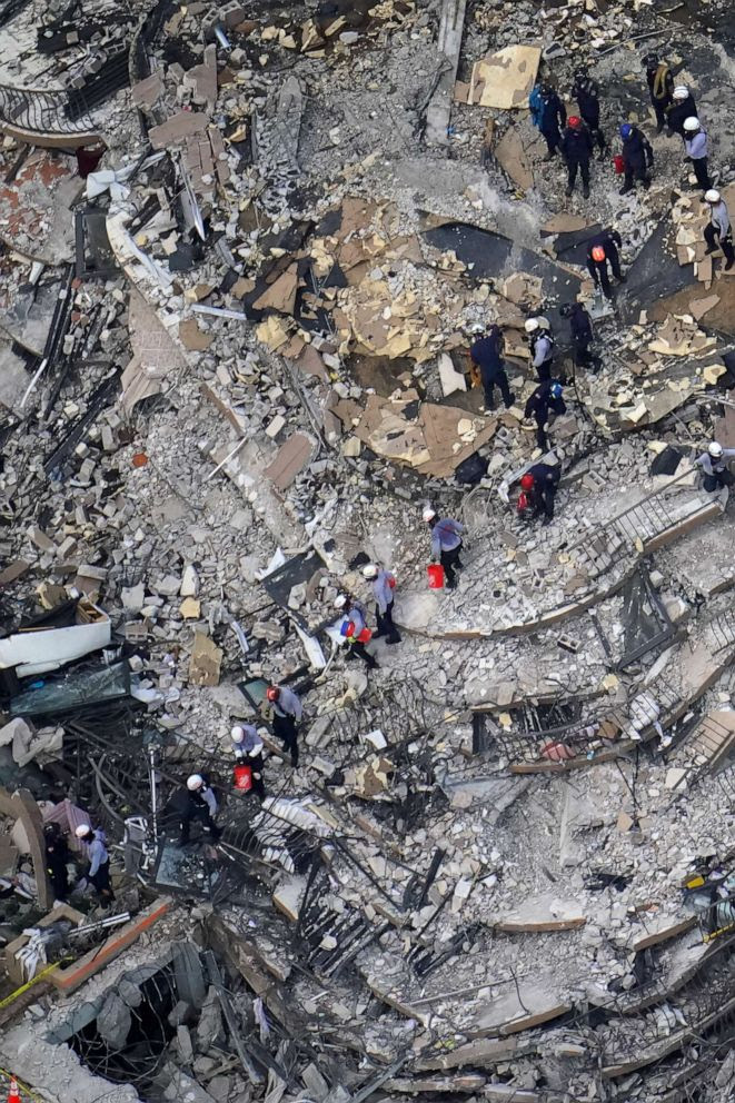 Overhead view of rescuers combing through the debris