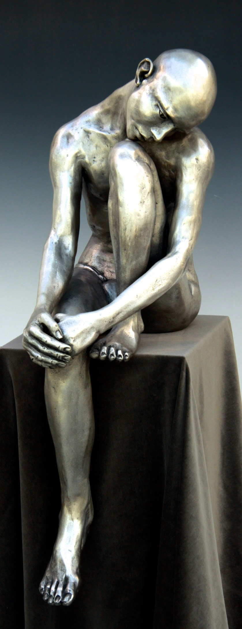 Silver Seated Man  3-Full 56L- L-Bob Clyatt Sculpture