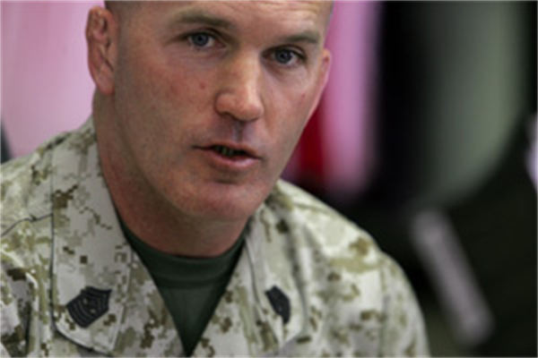 Navy Cross recipient Sgt. Maj. Bradley A. Kasal talks about leadership to hundreds of Marines on Camp Pendleton May 4. Before and after the presentation, Kasal signed copies of his book, ?My Men are My Heroes.? (Photo by Cpl. Ray Lewis)