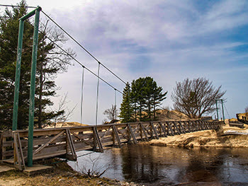 A walking bridge is shown over the Two-hearted River in northern Luce County.