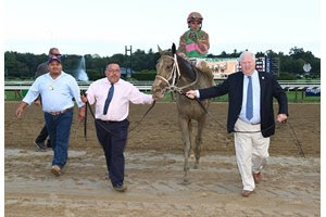 Lee Pokoik (right) leads Sippican Harbor into the winner's circle at Saratoga Race Course