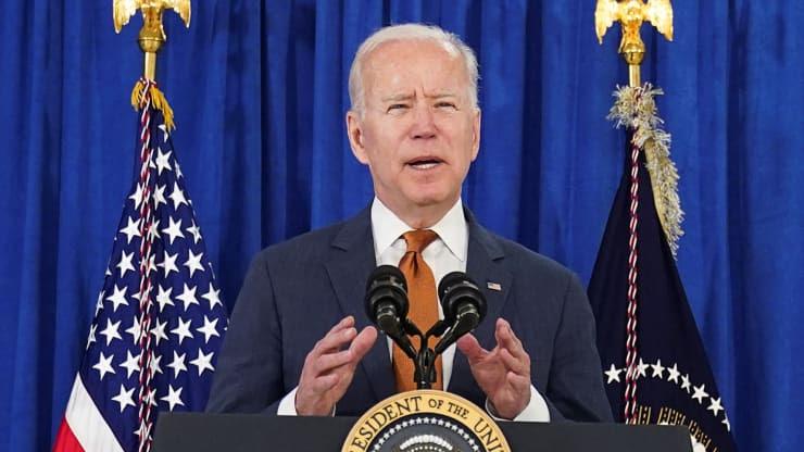 President Biden gestures behind a podium