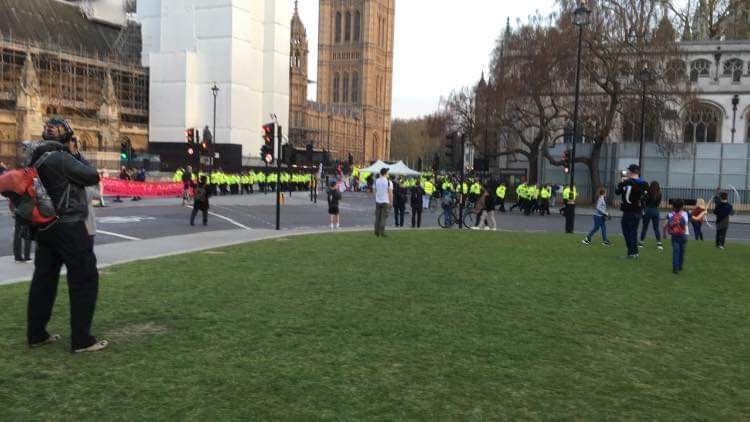 Policemen gather on the green in Westminster.