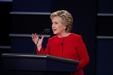 """Hillary Clinton on Monday night. Frank Luntz, a Republican pollster, wrote on Twitter that Mrs. Clinton """"has had the best debate training I've seen in years."""""""