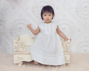 Asian Girl White Dress in Chair