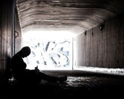 homeless person in a tunnel
