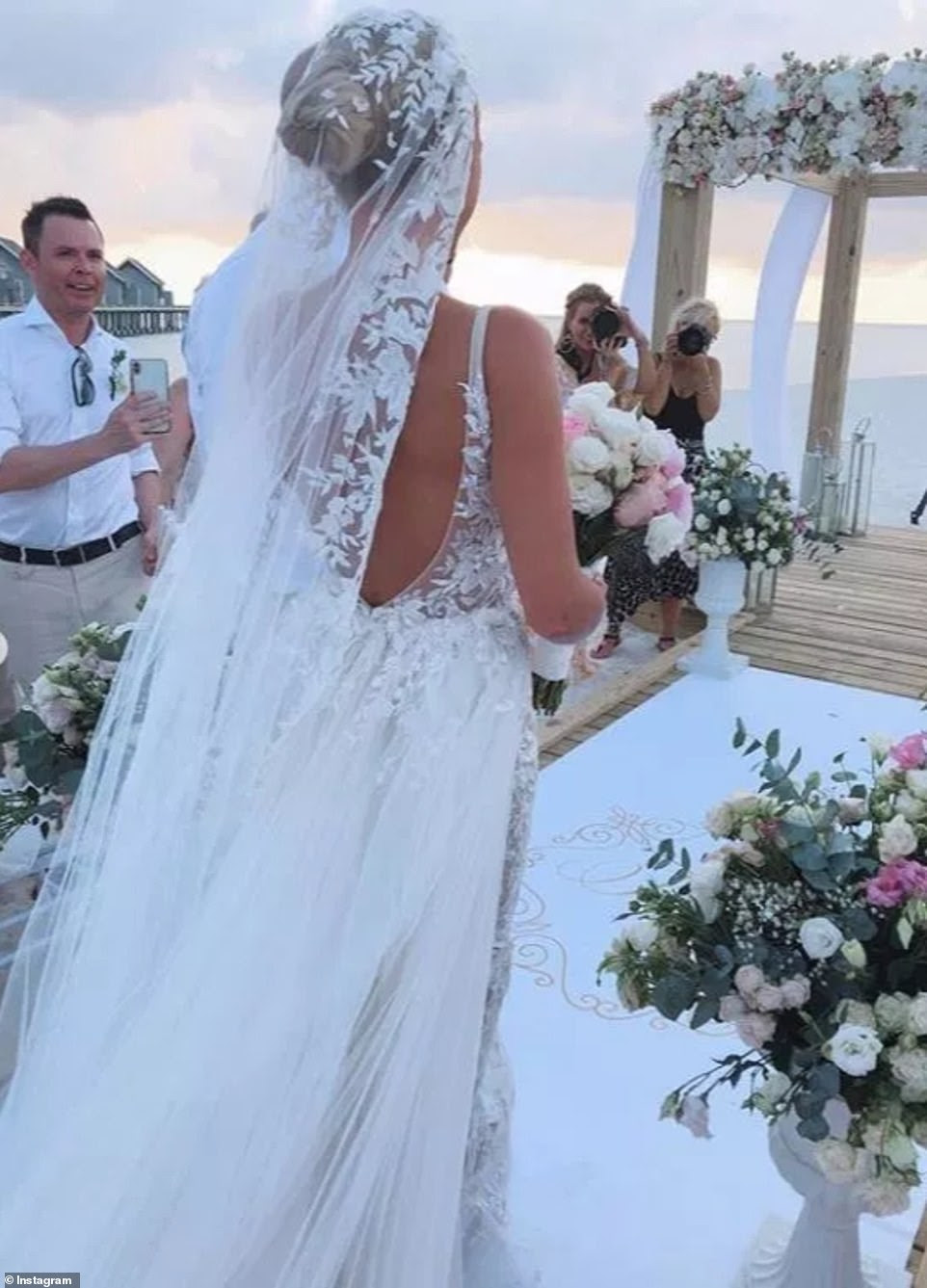 Incredible: Another snap showed Billie's beautiful white lace wedding gown as she made her way down the aisle