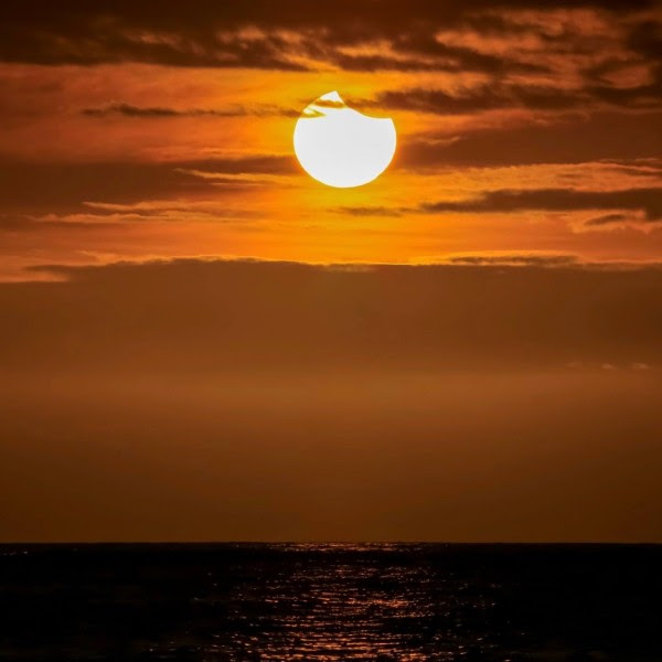 It was a partial solar eclipse sunset from the Big Island of Hawaii on March 8, 2016, said Chris Tinker.  Thanks, Chris!