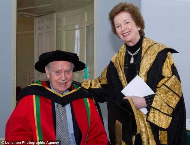 Mr Feeney pictured receiving an honorary doctorate from Mary Robinson, the Chancellor of the University of Dublin last year