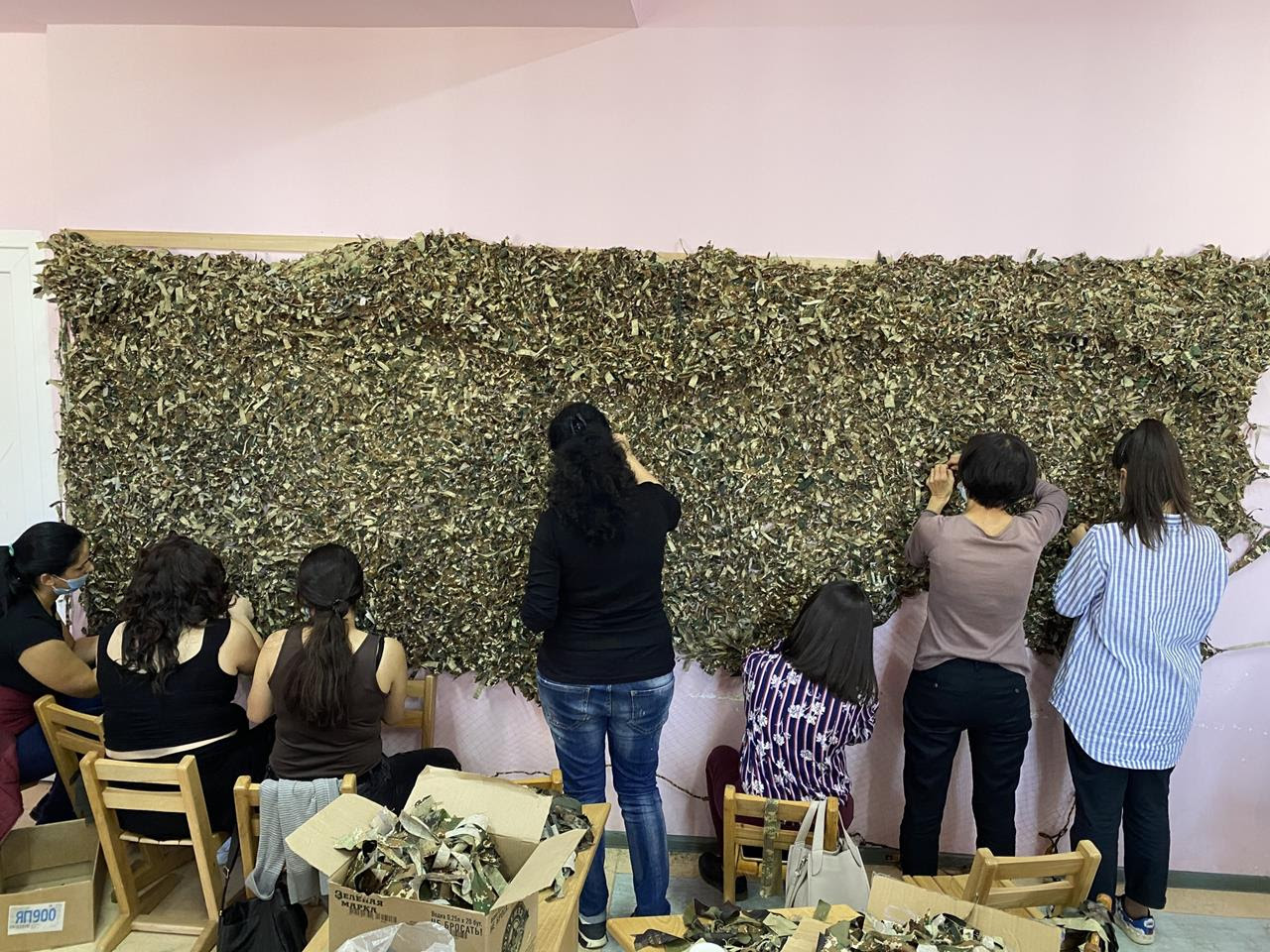 Women volunteers construct camouflage nets to be used on the Nagorno-Karabakh frontlines.