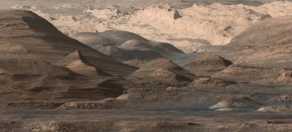 It is not Arizona or Utah...this is planet Mars as seen by Curiosity on September, 2015.  This image shows regions that include a long ridge teeming with hematite, an iron oxide. Just beyond is an undulating plain rich in clay minerals. And just beyond that are a multitude of rounded buttes, all high in sulfate minerals. The changing mineralogy in these layers of Mount Sharp suggests a changing environment in early Mars, though all involve exposure to water billions of years ago. Image via NASA/JPL-Caltech/MSSS