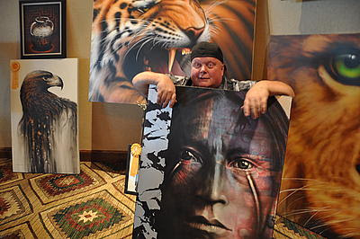 "San Jacinto High School art teacher Stephen ""Steve"" Talley displays some of his artwork in 2011. Photo Credit: GAIL WESSON / The Press-Enterprise)"