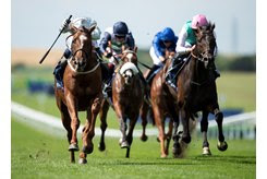 Communique (white cap) romps home in the Princess of Wales's Stakes at Newmarket