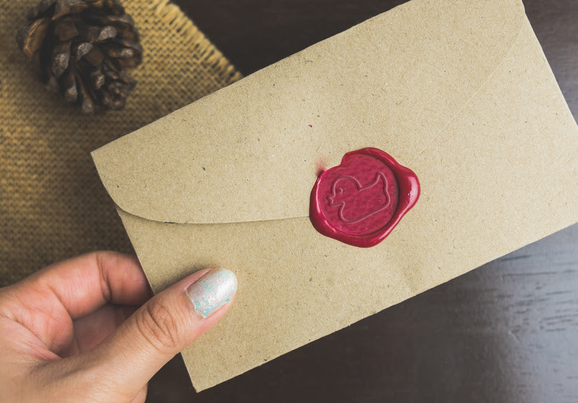 Unopened wax seal on the back of an envelope.