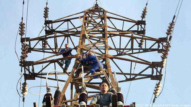 Albanian power utility workers repair th
