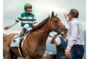 Accelerate, jockey Victor Espinoza, and owner Kosta Hronis after their win in the Gold Cup at Santa Anita