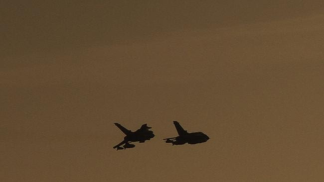 A pair of British war planes return to base near the southern city of Limassol.