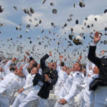 1280px-US_Navy_110527-N-OA833-014_Newly_commissioned_Navy_and_Marine_Corps_officers_toss_their_hats_during_the_U.S._Naval_Academ