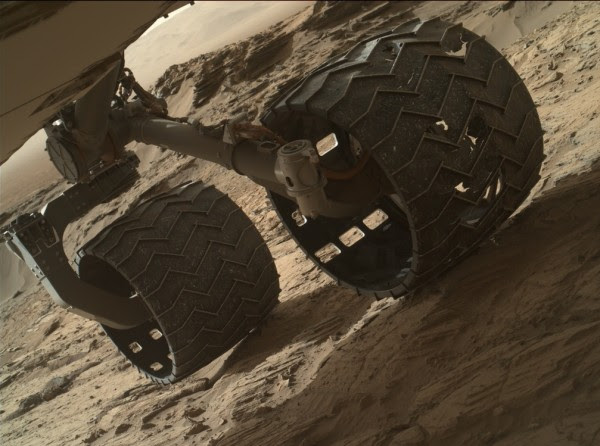 Damage on the aluminum wheels is evident after 7 miles (11.3 km) on the odometer of the Curiosity rover. Mars' terrain and diverse rocks led to more wheel damage than was expected. However scientists think the 20 inches (51 cm) wheels may permit the rover to continue its mission. Image via NASA/JPL-Caltech/MSSS