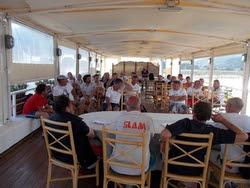 J/24 sailing teams at Cala Galera, Italy