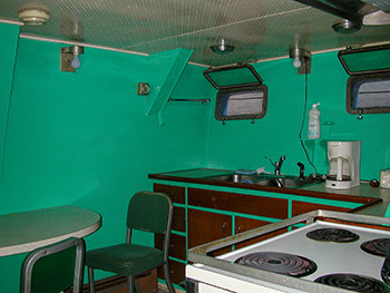 The basic green-colored galley aboard the Survey Vessel Steelhead is shown.
