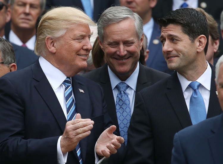 Trump stands with Paul Ryan andMark Meadows at the White House Rose Garden. (Mark Wilson/Getty Images)