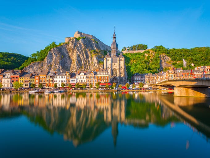 The                                                           riverside                                                           Collegiate                                                           Church of                                                           Notre-Dame in                                                           Dinant,                                                           Belgium, was                                                           destroyed in                                                           both World War                                                           I and II, but                                                             the rebuilt                                                           version with                                                           its bulbous                                                           spire is                                                           postcard                                                           perfect.