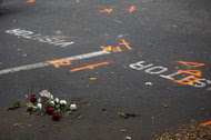 Flowers left at the parking space that now serves as a crime scene.