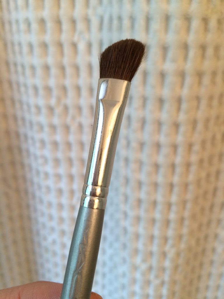 use a soft angled brush to contour nose