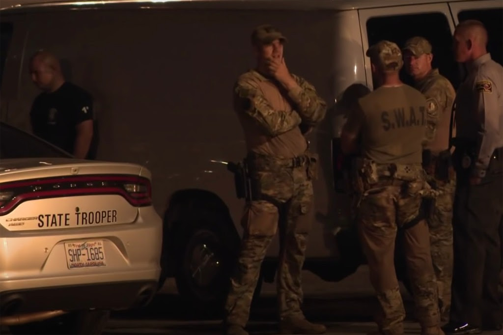 Deputy killed, another wounded in an hours-long standoff with gunman in North Carolina