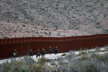 Border Patrol agents near Jacumba, Calif. President Trump plans to direct funds toward a wall.