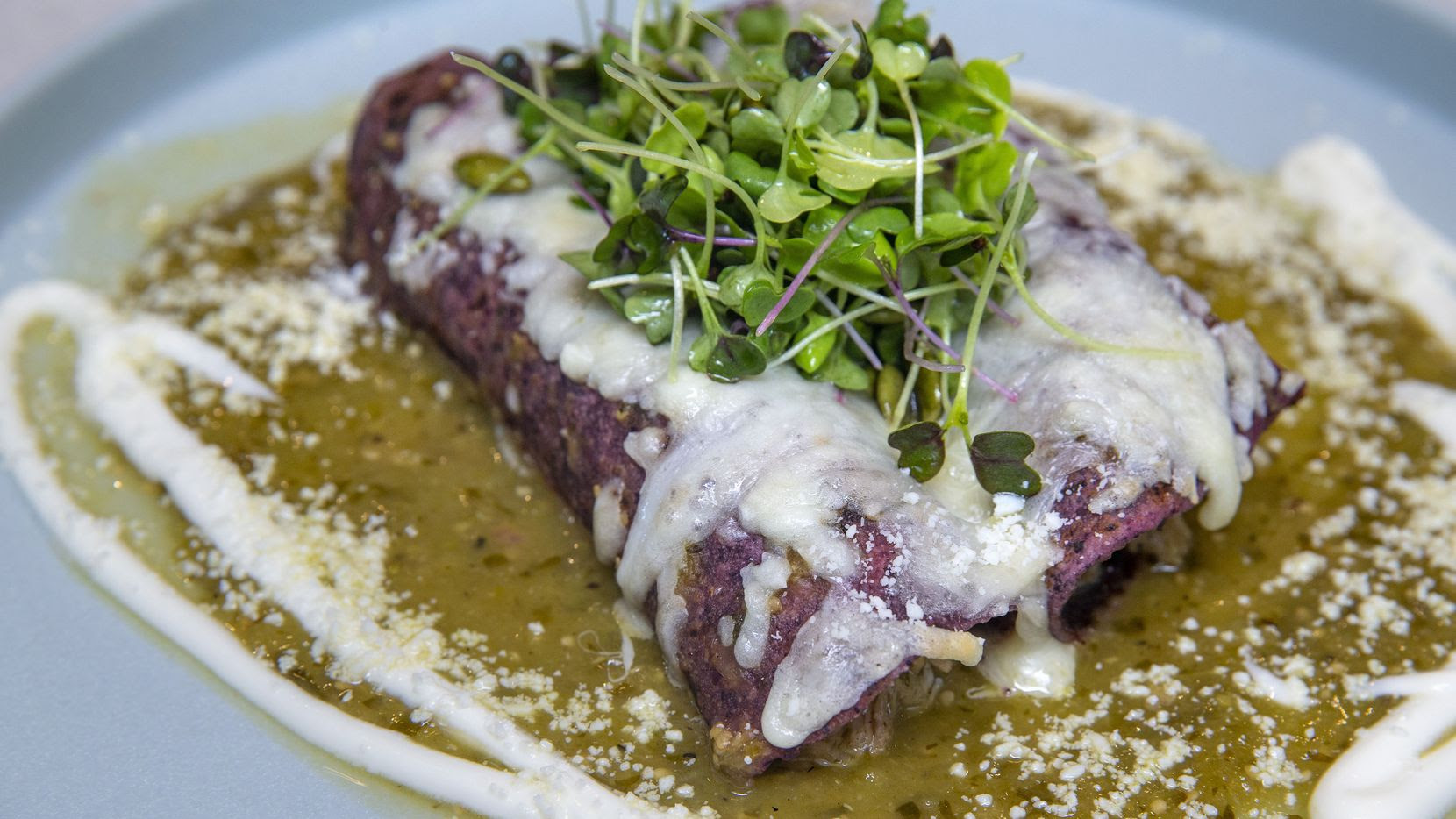 The Tipsy Chicken enchilada plate, prepared by Lada chef-owner Michael Ehlert, is made with beer-braised chicken and tomatillo sauce. Ehlert is set to open Lada restaurant in mid-November in Far North Dallas, near the western border of Richardson.