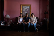 Amanda Lara, left, with her parents Guillermo and Sandra Lara at their home in Hazleton, Pa.