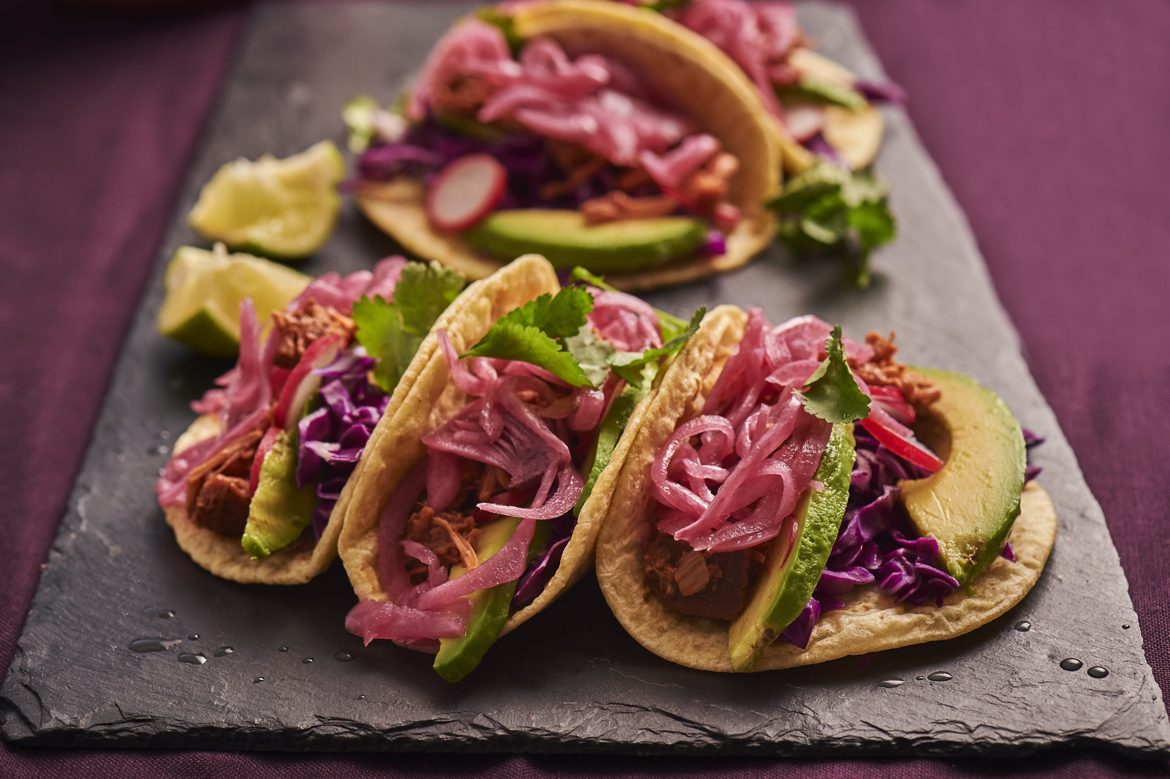Pulled jackfruit tacos finished with red onion.jpg