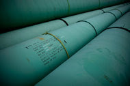 Pipe is stacked at the southern site of the Keystone XL pipeline in Cushing, Okla.