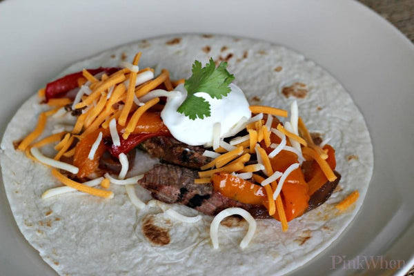 Beef Fajitas, Pico, Coriander Sour Cream, Cheddar Cheese, Lettuce, Caramelized Peppers and Onions with Corn or Flour Tortillas