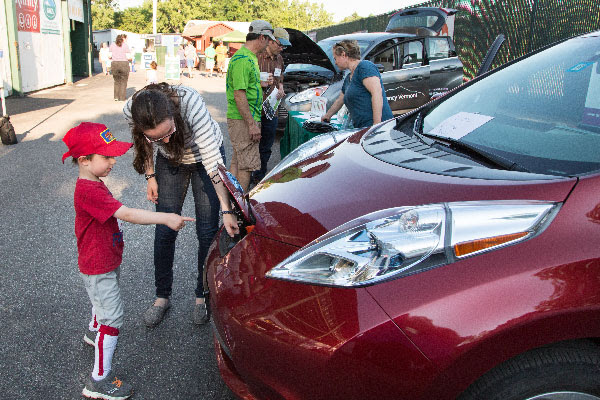 people at an electric vehicle event