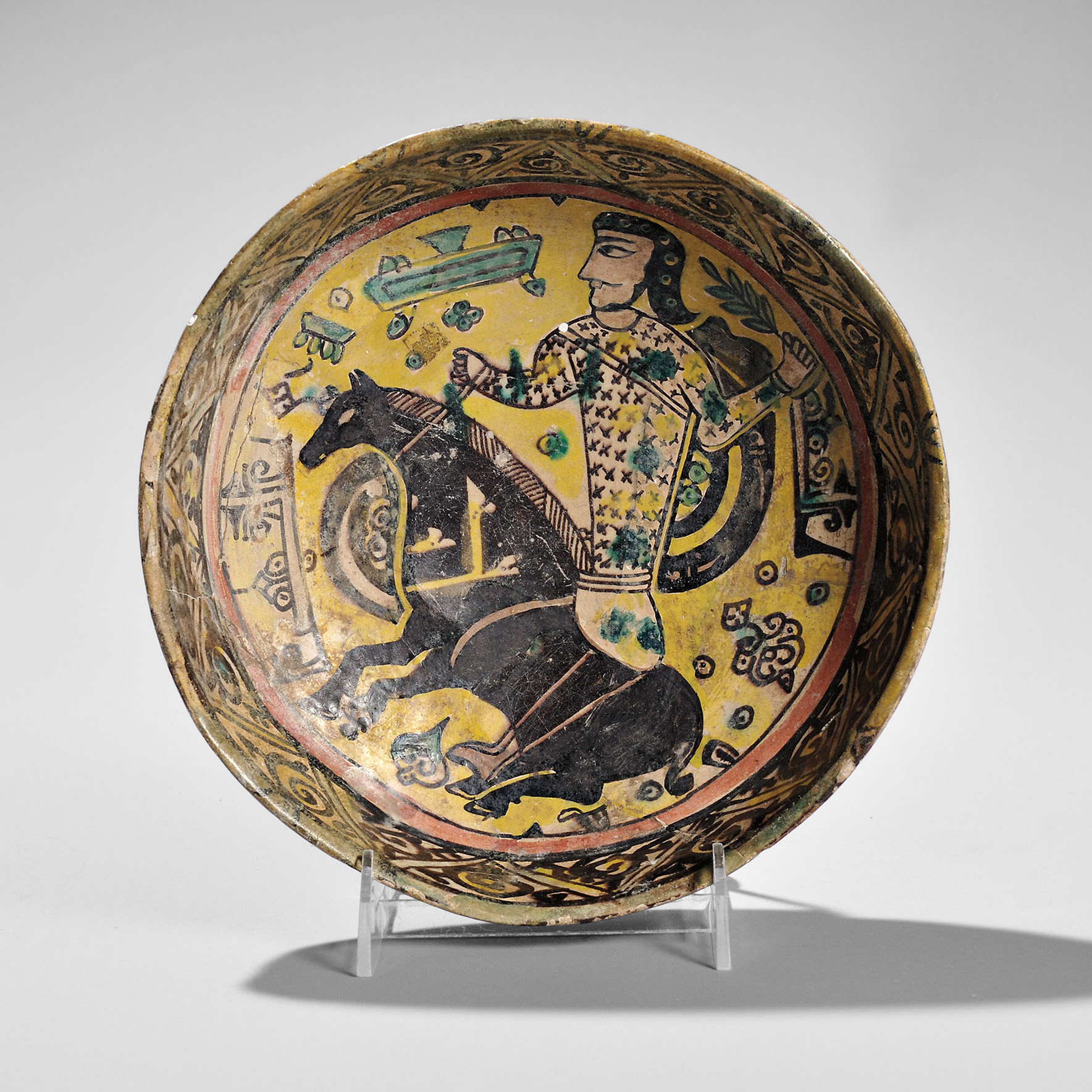 Brown-glazed Low Bowl, Persia, possibly 13th century (Lot 39, Estimate $2,000-3,000)