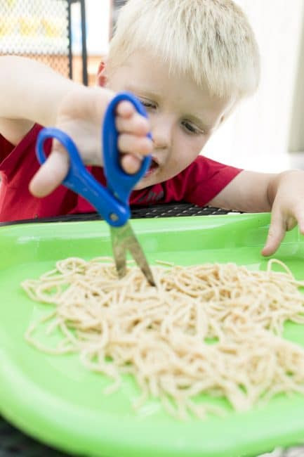 Cutting food is one of these great cutting activities for kids to learn scissors skills