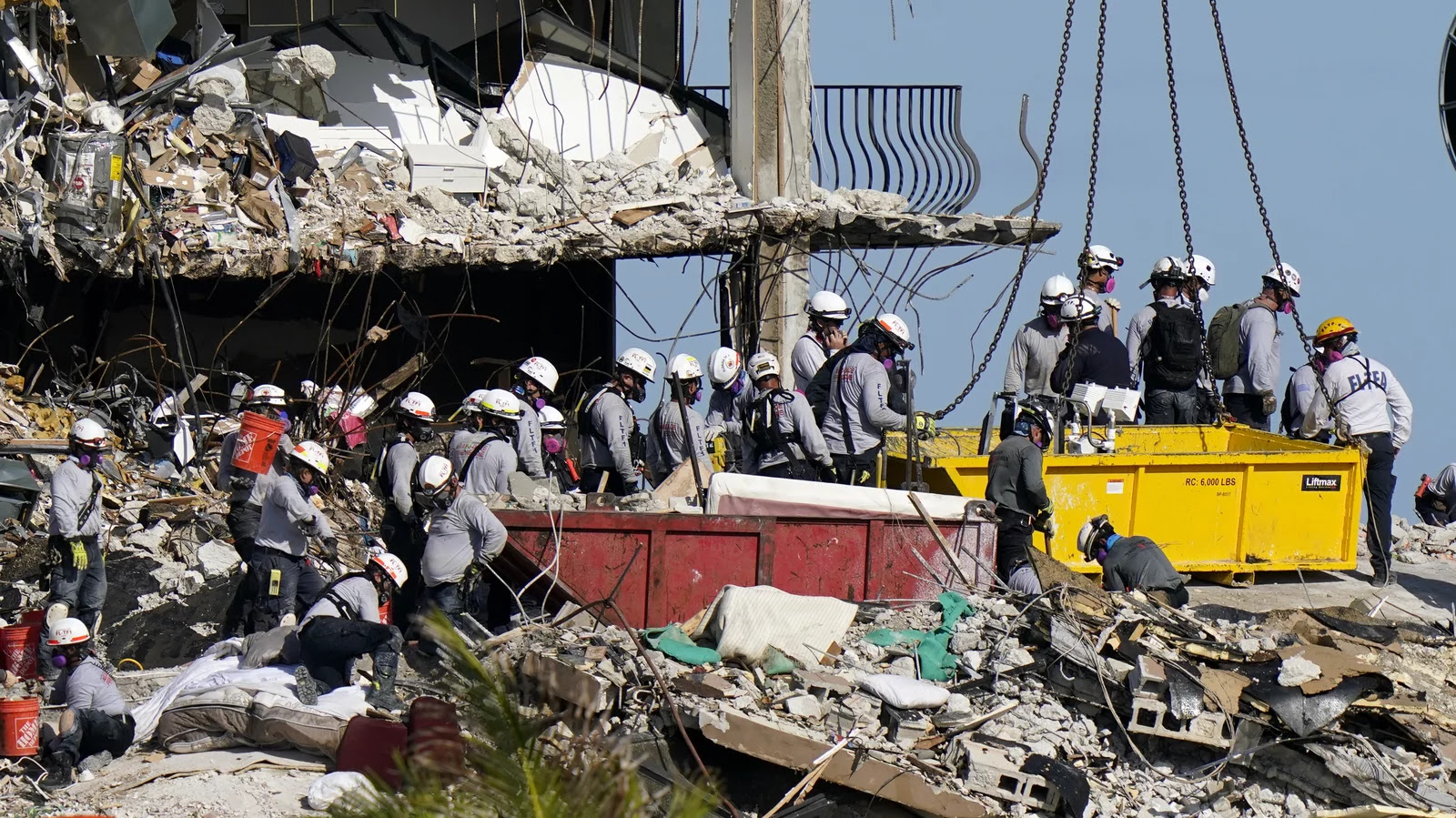 Rescue workers combing through the debris of the condo collapse in Surfside, Florida