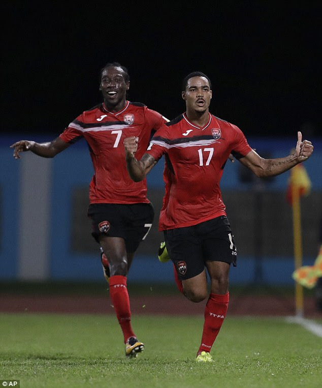 Trinidad and Tobago's Alvin Jones (17) celebrates with teammate Nathan Lewis after scoring against U.S. during a World Cup qualifying soccer match in Couva, Trinidad