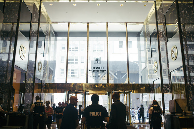 Police are seen inside Trump Tower in Manhattan. (John Taggart for The Washington Post)