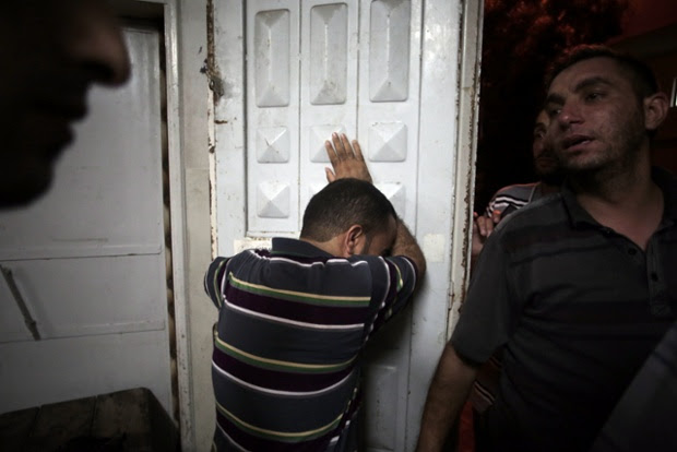 Palestinians mourn in the morgue of Shifa hospital in Gaza City.