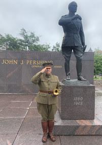 Taps bugler at the Pershing Memorial statue